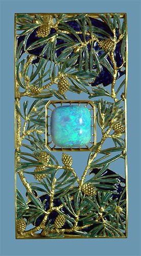 Lalique 1900-01 signed 'Eagles on Pine Tree Branches' dog collar plaque: an articulated, gently curved plaque. Two enamel & gold eagles face a large opal among light green enamel & chased gold pine tree branches & pine cones. Acquired from the artist in 1901, Calouste Gulbenkian Museum