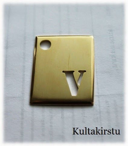 Messinkinen avaimenperä - Key fob from brass