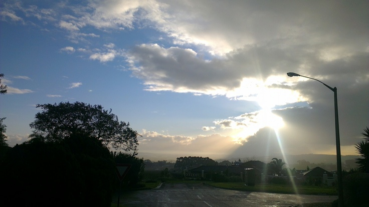 Awesome sun shining from behind a strange cloud formation. Taken from Somerset West