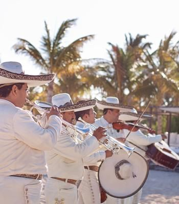 a wedding in mexico isn't complete without mariachis