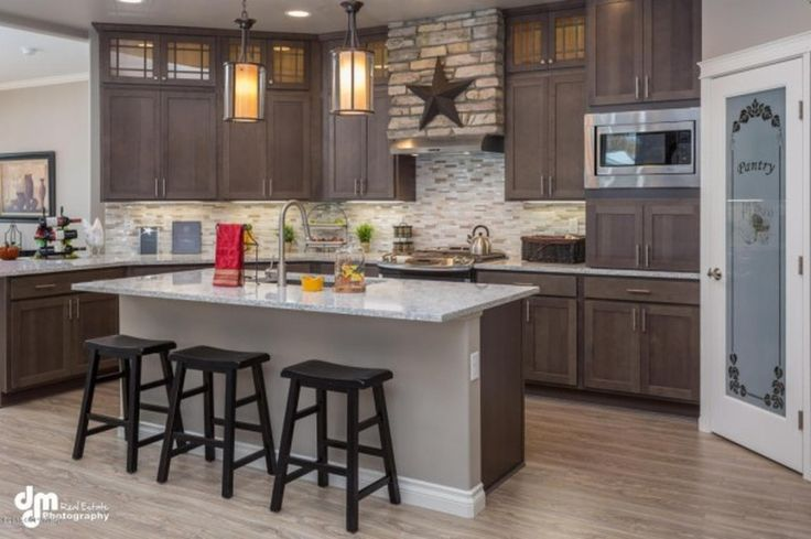 A crisp kitchen design is the highlight of House Plan 3245, a popular craftsman #houseplan with an open floor plan. http://www.thehousedesigners.com/plan/marymoor-3245/