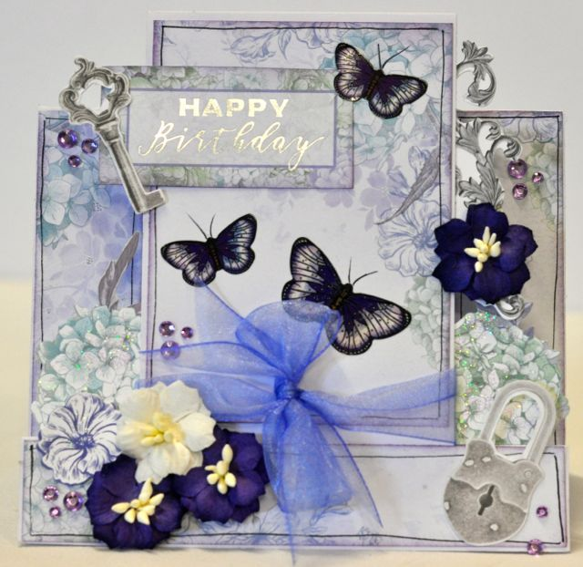 A step card by Kelly-ann Oosterbeek made using the Lilac Whispers Collection from Kaisercraft and Imaginarium Designs Chipboard www.kellyanno.com