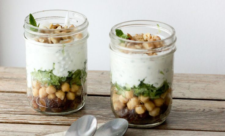 This springtime savory parfait layered with yogurt, mint, chickpeas, raisins, and walnuts is the perfect, fresh, and healthy vegetarian lunch or snack.