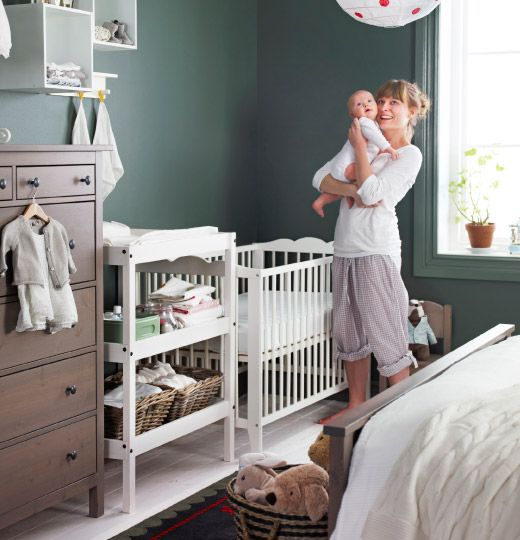 Great way to create a shared nursery space using white baby furniture and a surprising wall color.