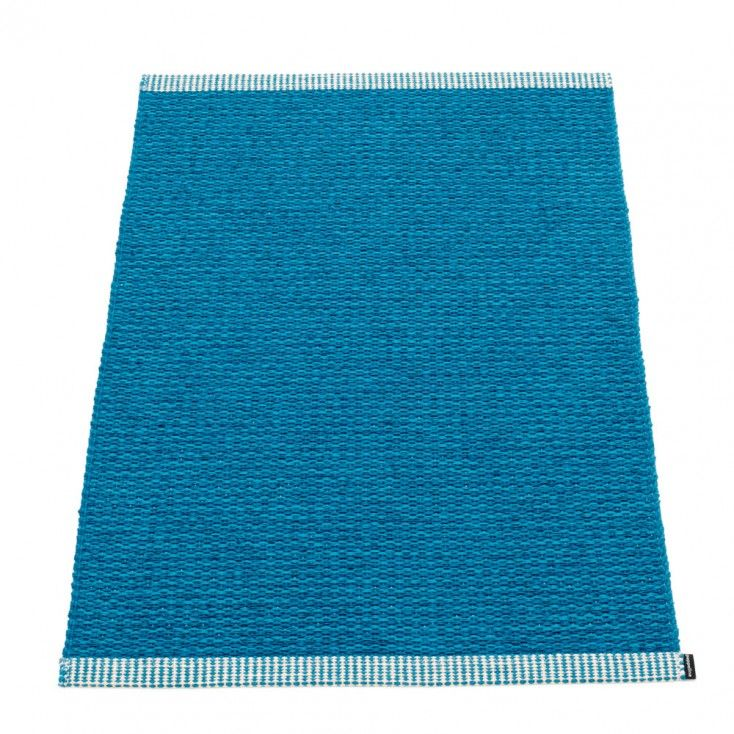 Woven using a blend of two shades of petrol blue, Pappelina's dainty Mono mat is perfect for protecting every floor type in all areas of the home. The slender 60 cm width is ideal for tight spaces, such as shower rooms and narrow hallways, it's also great for caravans and camper vans too. Pappelina mats are woven from soft plastic using traditional Swedish techniques, they are fully reversible and washable, although a quick vacuum is probably all they will ever need.