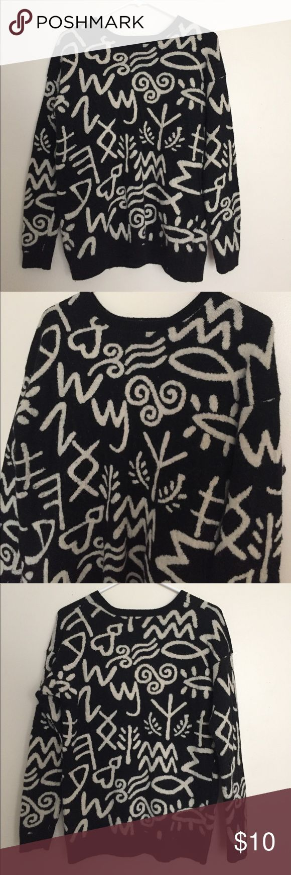 Thick black sweater Cozy thick black sweater with off-white designs. Has little fuzzys coming off the sweater which was bought this way. Only worn once- good condition. Looks great with black leggings and boots! Forever 21 Sweaters