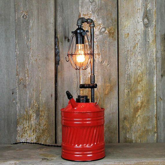 Kerosene Can Industrial Table Lamp This stunning lamp features steampunk industrial styling composed of early 20th-century vintage parts combined with new electrical and steel components. Standing at 21 inches tall and measuring 7 inches wide. The focal point of this unique piece is