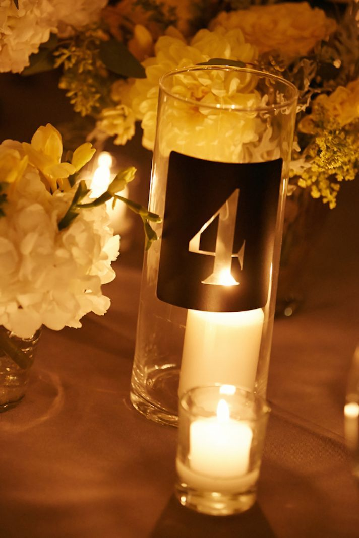 love the idea of an engraved candle votive as a table number wedding reception