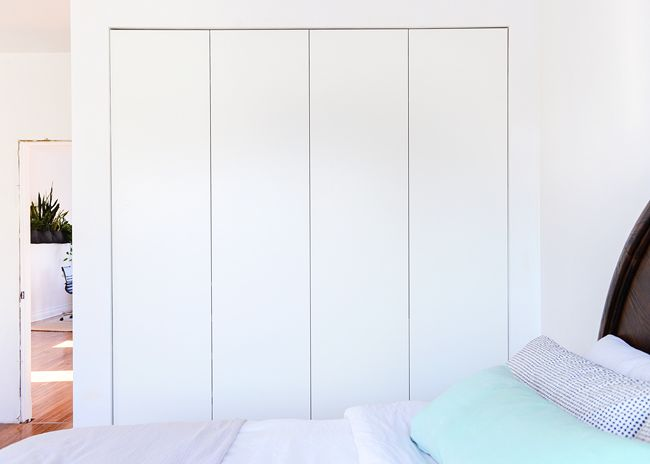 NOTE: IKEA Pax closets -- 8' tall, 7' wide, 2' deep, eliminating need for dressers in room