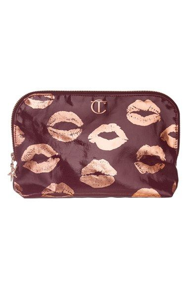 Free shipping and returns on Charlotte Tilbury 'Second Edition' Makeup Bag at Nordstrom.com. Charlotte Tilbury has created the perfect winter case in a patent, Night Crimson finish that wipes clean to last all year long. Much like the original bag, the front is adorned in secret celebrity kisses, now in a rose-goldtone. A new celebrity kiss has been added, too, however it's top secret, so Charlotte will never reveal whose stolen kiss it is.