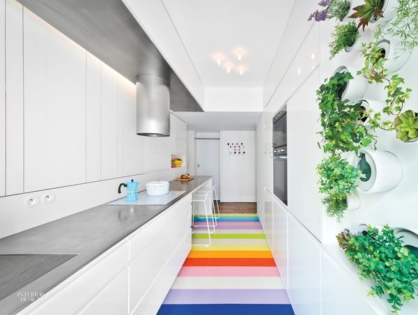 SABO Invigorates a Fashion Forecaster's Paris Apartment with a Cheerful Array of Colors  The stainless-steel countertop was welded on site. Photography by Alex Delaunay.