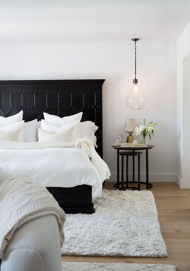 "On the master bedroom: ""The client's favorite color palette is black and white so we stuck to mainly those tones for this space. The focus on this room was to emphasize layers and textures to..."