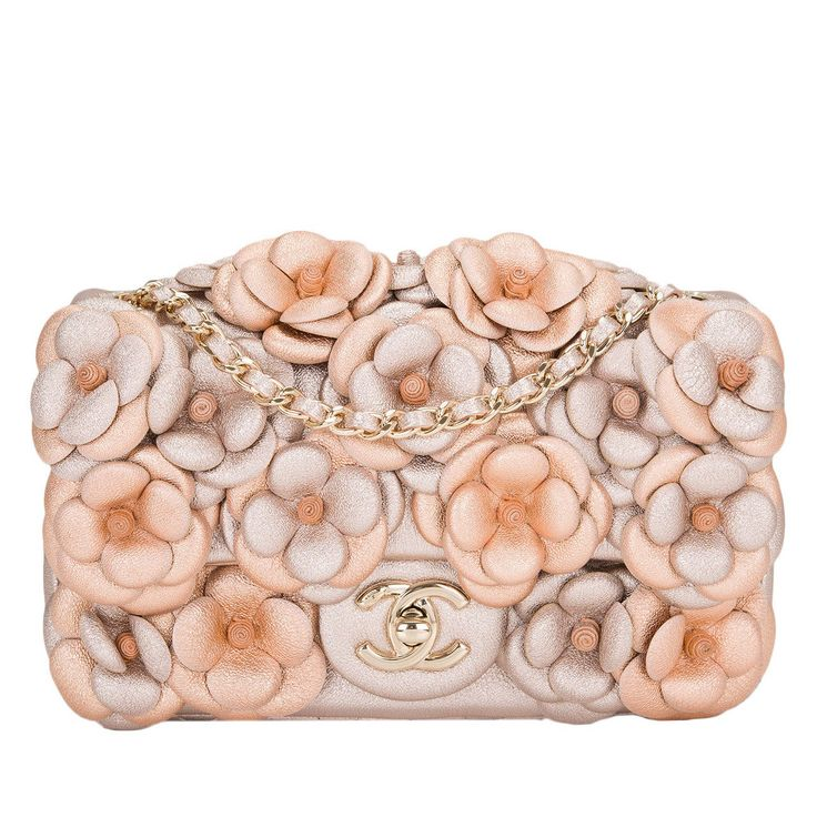 Chanel Pink Quilted Camellia Flap Bag   From a collection of rare vintage shoulder bags at https://www.1stdibs.com/fashion/handbags-purses-bags/shoulder-bags/