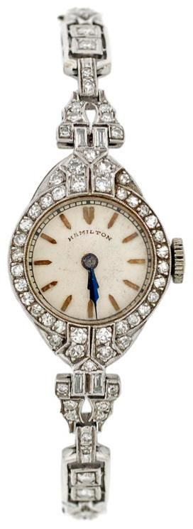 Hamilton Lady's Art Deco Platinum and Diamond Bracelet Watch. Circa 1920s. A lovely platinum and diamond Hamilton watch from the Art Deco era (circa 1920). The band of the watch is made of platinum links which are encrusted with diamonds.