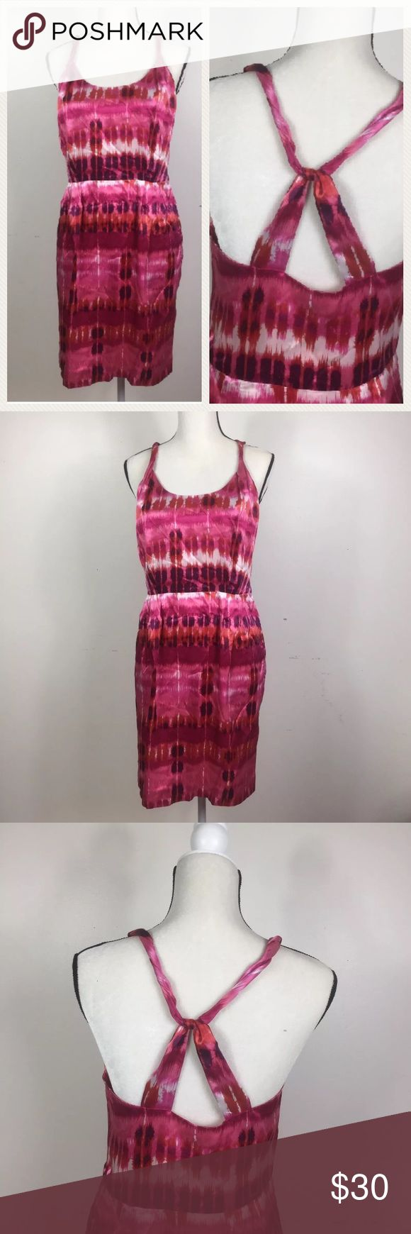 NWT Banana Republic 100% Silk dress tie dye Brand new with tag Banana Republic Dress with twist back design and pockets. Pink and purple tone with prints. Super soft & luxurious 100% silk exterior (lining is poly).  Size: 8P (8 petites)  Condition: new with tag Measurements: 18 inches across underarm / 16 inches across waist / 21 inches across bust / 37 inches long Banana Republic Dresses Mini