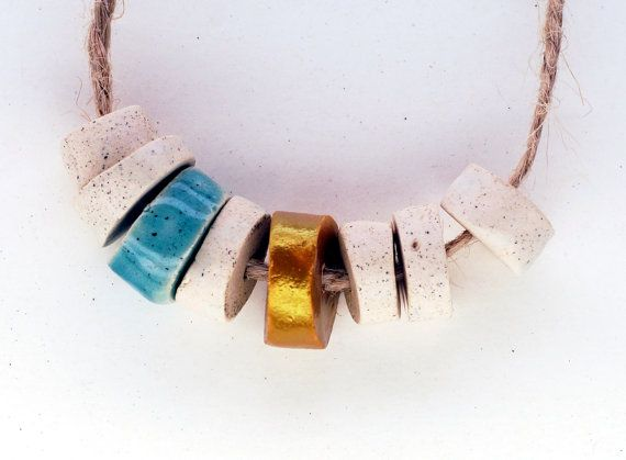 It is enough -- a set of 8 satin white, turquoise and golden small ceramic beads