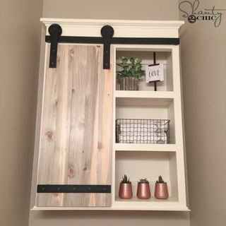 I can't even explain how excited and in LOVE I am with my new Sliding Barn Door Bathroom Cabinet! I'm obsessed with sliding barn doors and there isn't a spot in my home to install one – so, I created