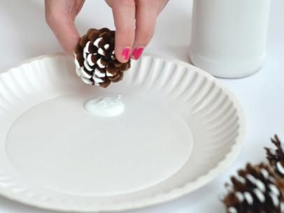 Dipping Pinecone's Edges in White Paint