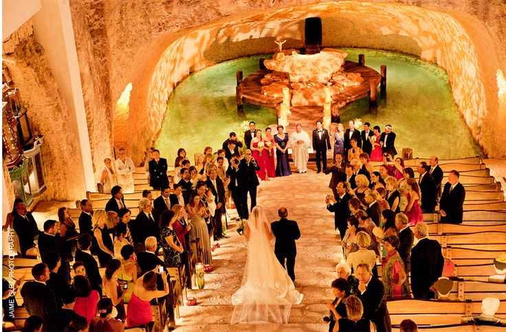 Underground wedding ceremony at the magical chapel our lady of Guadalupe in  Xcaret eco park Mexico.