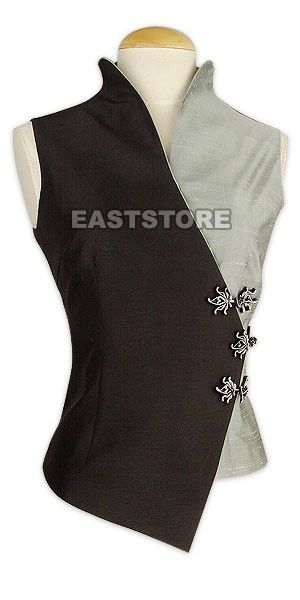 Words cannot do justice to this Two-tone Silk Sleeveless Blouse! A wonder of elegant design, this...