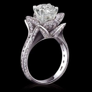 5 carat diamonds flower shape engagement ring in 14K gold. $17,850  WOW!
