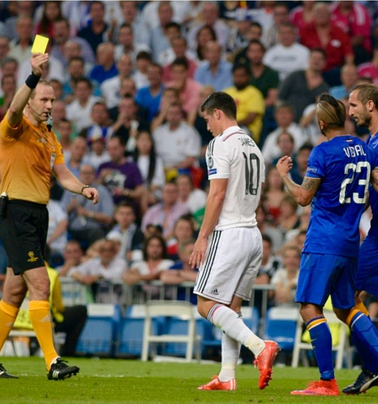 James Rodríguez (L 2) of Read Madrid is shown yellow card during the UEFA Champions League semifinal second leg soccer match between Real Madrid and Juventus FC at the Santiago Bernabeu stadium in Madrid, Spain, on May 13, 2015