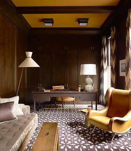 Modern and masculine, with a touch of modern at the desk - Steven Gambrel. Pull in a piece of quirky furniture by painting the ceiling the same color.