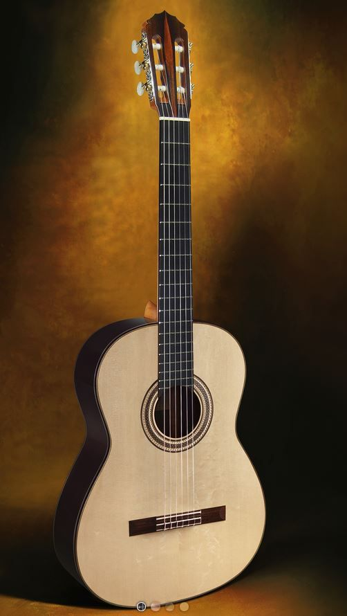 Classical Guitars Jeffrey R. Elliott, USA Concert Model TBD Rodgers Tuning Machines Expected new 2019 Call for Price Inquire Here: 216.752.7502 Sides and back TBD, soundboard TBD, Elliott open harmonic bar bracing pattern, Rodgers L180 precision tuning machine heads (the finest in the world) with rare sterling silver engraved side plates and self-aligning bearing bushes, hand rubbed French polish of shellac finish, 650mm string length, hard shell case,. (Actual guitar not shown)…