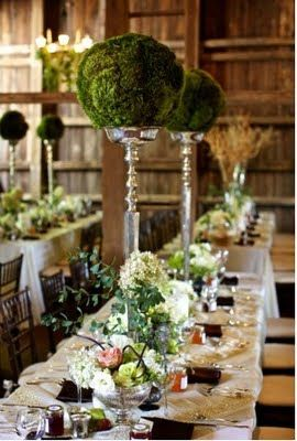 Moss centerpiece on silver floral stand.  Floral stands available at www.hdaltd.com #floralstands