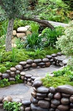 Moss mounds and decorative pebble waterfall in a traditional Japanese garden in Satoyama Life - Artisan Garden
