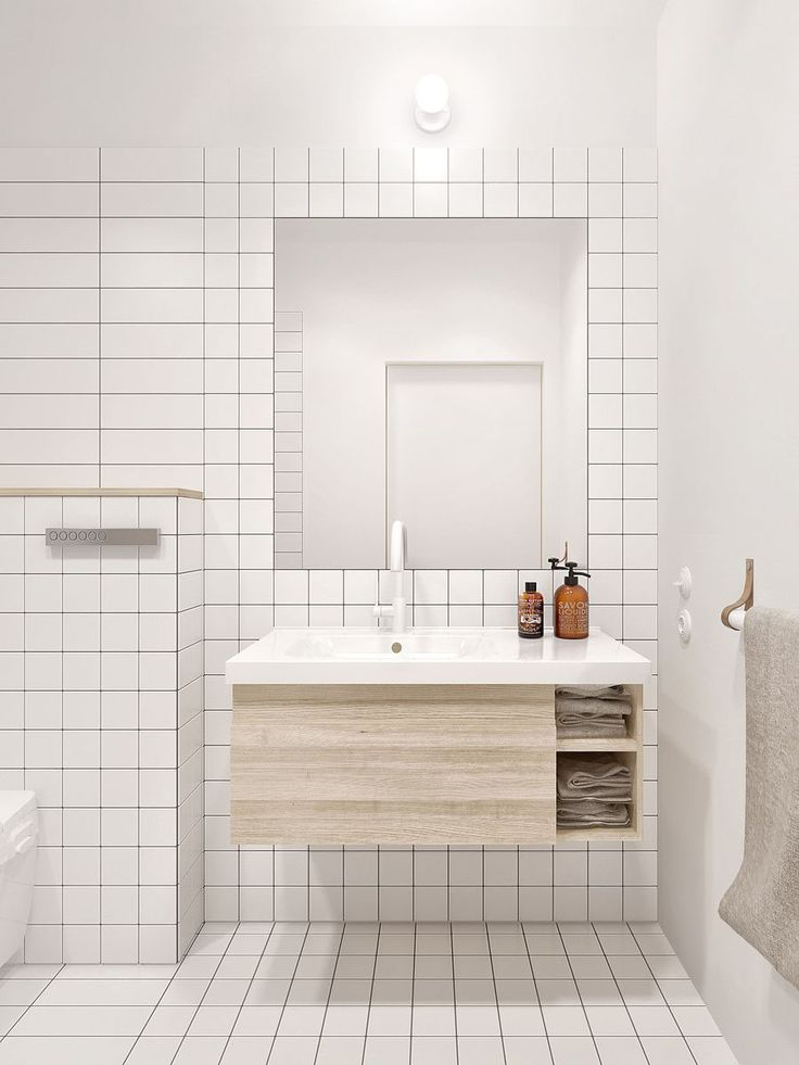 floating travertine cabinet in white bathroom