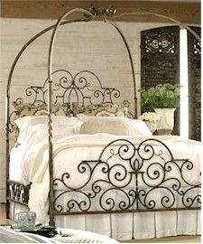 beautiful black iron bed with canopy works well in the romantic bedroom