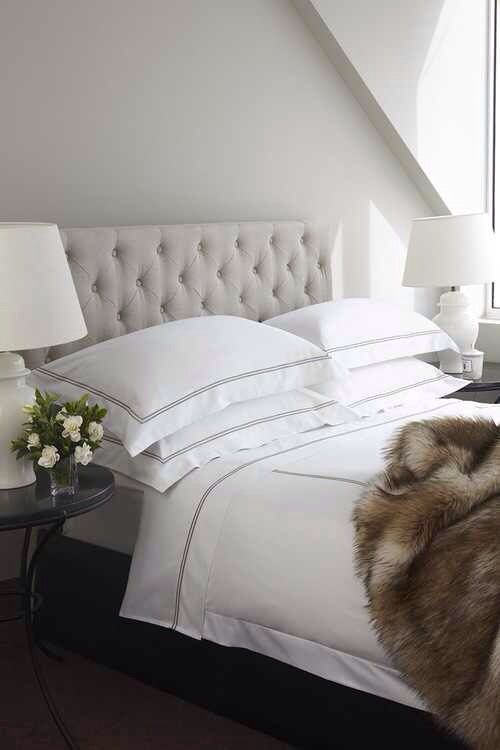 A simple fur throw can make a guest room cozy and welcoming
