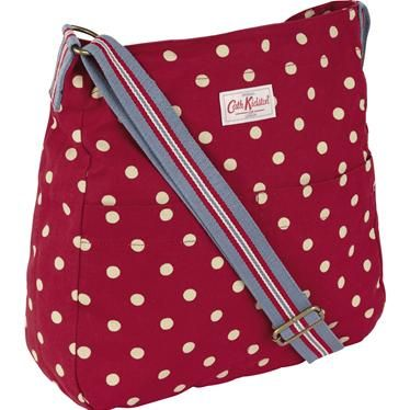 Our popular cotton messenger bag is a relaxed style that looks great worn across the body. This design features our classic Spot print, with quirky Mini Riding print lining and fully adjustable rainbow coloured handle. There are also some handy pockets, perfect for your phone or purse - two on the inside and two on the outside!