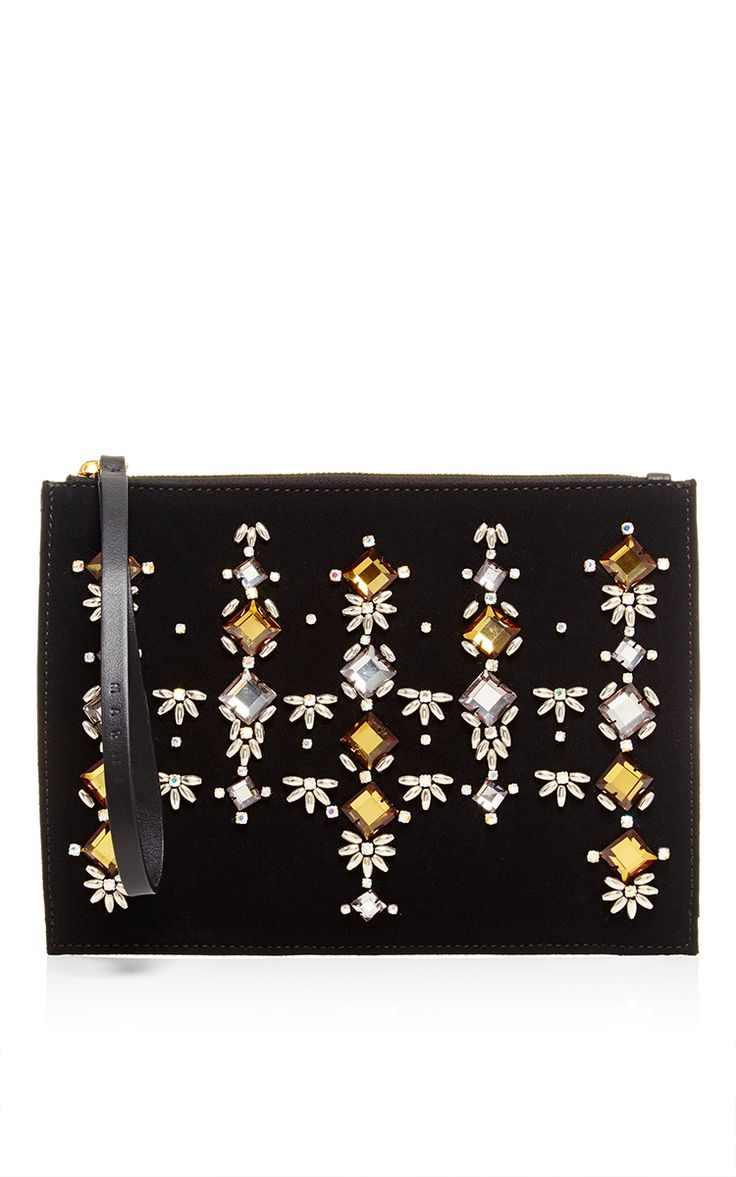 This Marni pochette is rendered in leather and features a top-zip design with jewel embellishments at the front. Preorder now on Moda Operandi