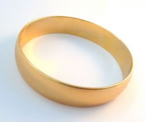 Vintage Monet Polished Gold Tone Bangle.