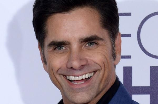 """Fuller House"" star John Stamos poked fun at himself on Instagram after having a wardrobe malfunction mid-performance with the Beach Boys."