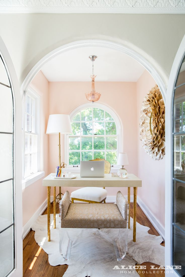 This teeny-tiny office with blush pink paint! Often times are clients are dumbfounded with what to do with these quirky little spaces in their home (and historic houses are notorious for having plenty of them!), but you'll find that if you work with them, instead of against them. A hair on hide rug, a Lucite bench, and incredible gold accents (that mirror!) make this a fun, sophisticated, and feminine space for comfort and creativity. | Designed by Alice Lane | Historic Ivy Flat