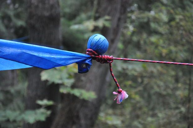 Tip for rigging a tarp cover: wrap up a tennis ball into the corners of tarp, instead of the grommets. Grommets can rip easily! Picture of Tip 2: Forget the grommets