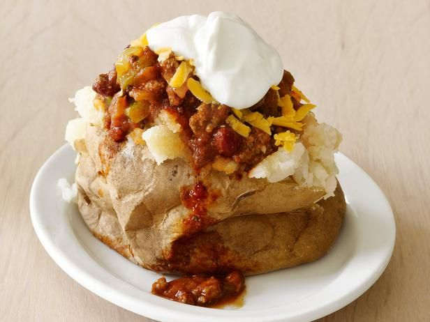 50 Stuffed Potatoes from FoodNetwork.com ~ some of these sound delicious!! - french onion, pizza, ham and swiss . . . yum!