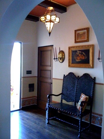 """Entrance completed for a california mediterranean home...hand painted dado with stencil work...ceiling washed in reddish orange glaze, beams given a """"faux"""" inlaid bone pattern..."""