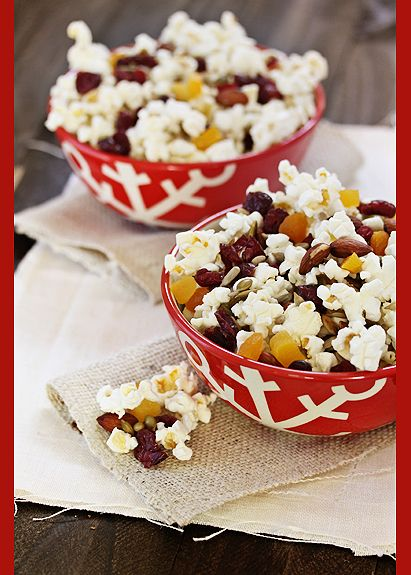1 envelope popcorn popped 1/4 t cinnamon 1/4 C sunflower seeds 1/4 C pepitas (pumpkin seeds) 2/3 C raw, unsalted almonds 1/3 C dried cranberries 1/2 C diced dried apricots Sprinkle hot, popcorn with cinnamon, tossing to coat evenly. In a separate bowl, combine the sunflower seeds, pepitas, almonds, cranberries, and apricots. Mix well. Toss the nut, seed, and fruit mixture with the popcorn.