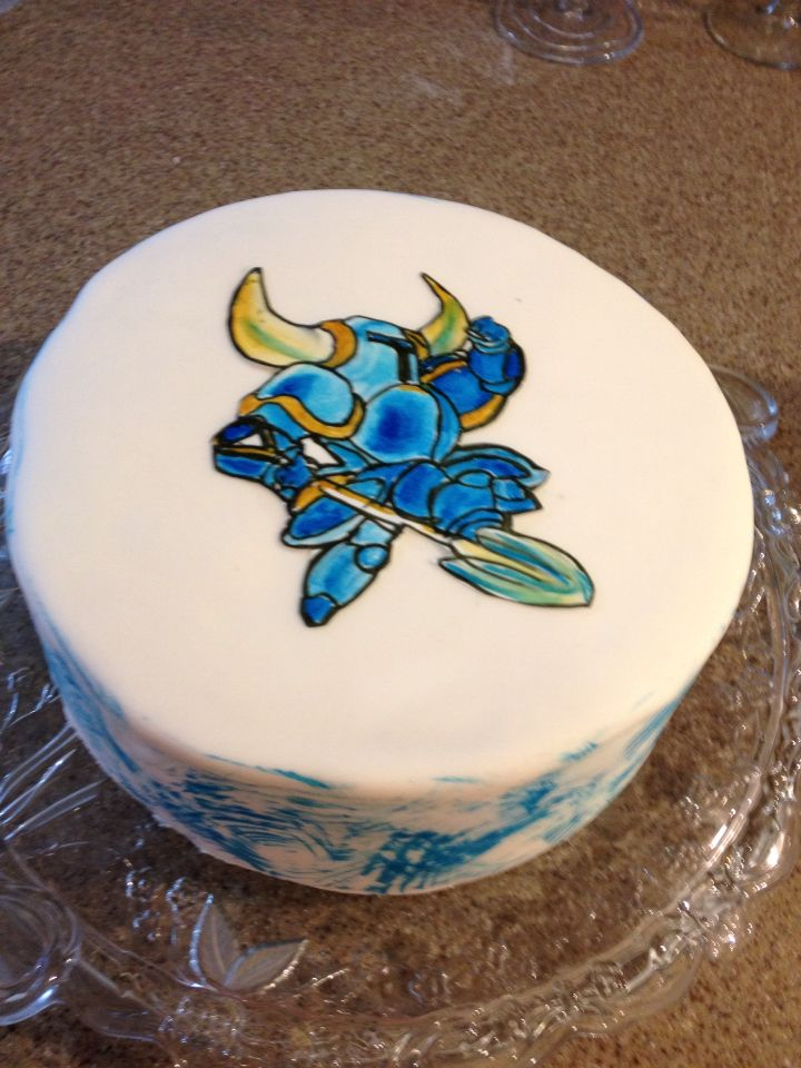 Shovel Knight game hero. Hand painted on an icing sheet,  then placed on the cake.