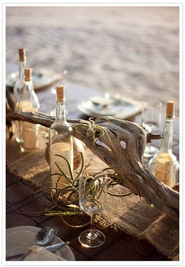 Driftwood centerpiece with burlap runner and Air plants. Love message in a bottle idea - guests can write advice on