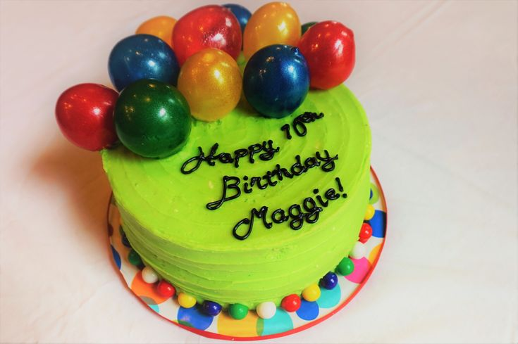 Lime green birthday cake with gelatin balloons