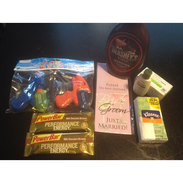 Honeymoon Kit: Kleenex, Lotion, personalized Bride and Groom door hanger, chocolate syrup, Performance Energy bars, Advil, squirt guns for a tropical honeymoon destination, and of course condoms ;)