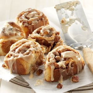 Brunch Cinnamon Rolls Recipe -A biscuit-textured cinnamon bun with the ease of food processor preparation. This family friendly breakfast bun is glazed with maple and vanilla flavors to accent the cinnamon and nuts.—Rita Vogel, Malcom, Iowa