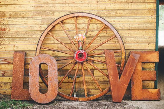 Rustic LOVE Sign and Wagon Wheel for a Ranch Wedding Workshop / http://www.deerpearlflowers.com/rustic-country-wagon-wheel-wedding-ideas/2/