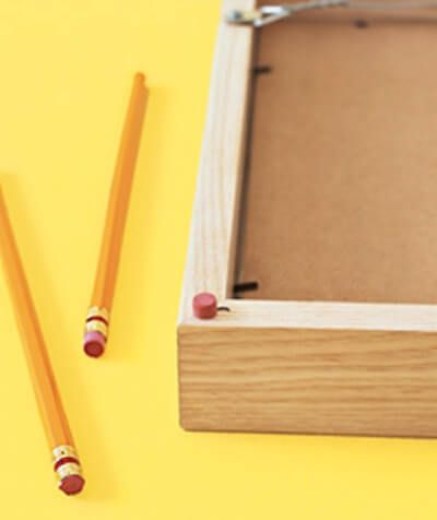 Pencil eraser picture frame protector