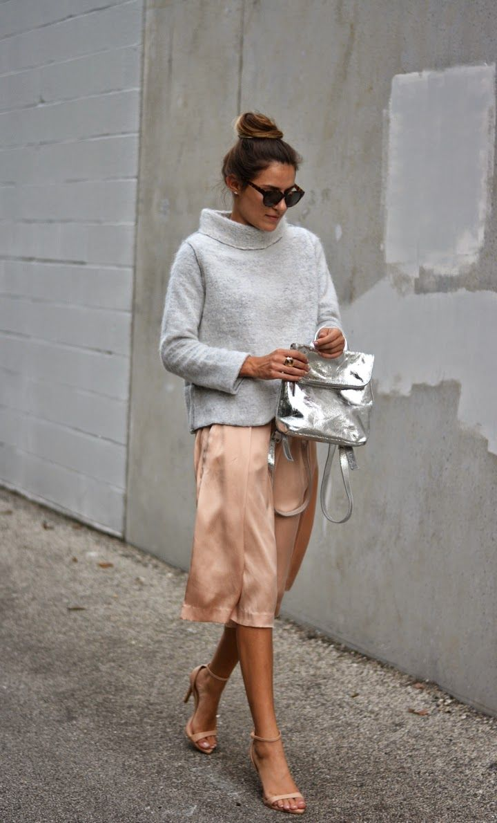 Grey knit turtleneck, silk blush skirt, nude strappy heels, and silver backpack style handbag